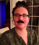 The author, celebrating her birthday mustache-style.