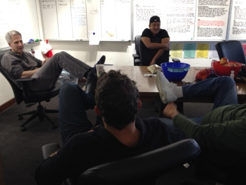 The dudes, deep in thought inside the BONES writers' room.